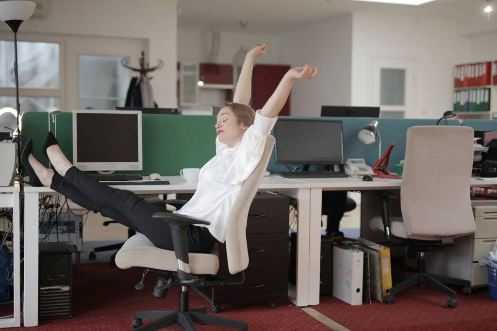 Woman stretching on office chair